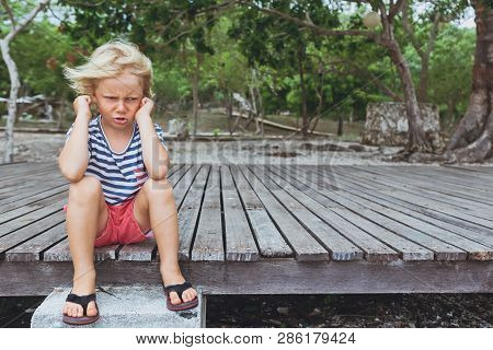 Funny Portrait Of Caucasian Kid Looking Annoyed And Unhappy. Upset And Angry Child Concept For Famil