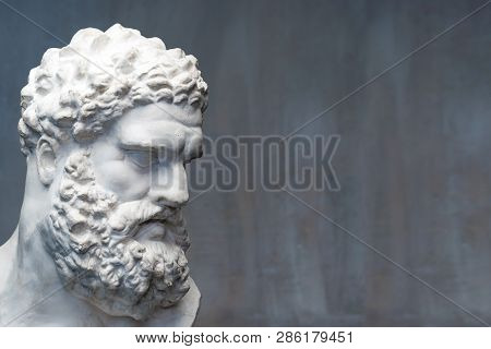 Bust Of The Farnese Hercules. Heracles Head Sculpture, Plaster Copy Of A Marble Statue. Son Of Zeus,