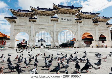 Taipei, Taiwan - November 06, 2018: Woman Rides A Bycicle In Front Of The National Chiang Kai-shek M