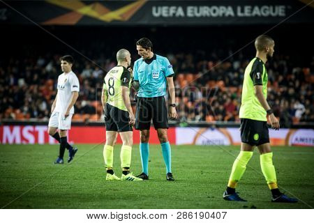 VALENCIA, SPAIN - FEBRUARY 21:(8) Brown talks with referee during UEFA Europa League match between Valencia CF and Celtic FC at Mestalla Stadium on February 21, 2019 in Valencia, Spain