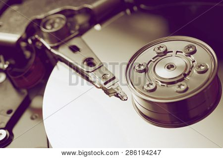 Closeup of an open computer hard drive.