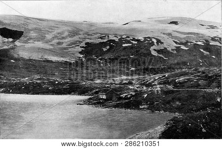 Mountainous landscape in Norway with its huge snowfields and descending glaciers, vintage engraved illustration. From the Universe and Humanity, 1910.
