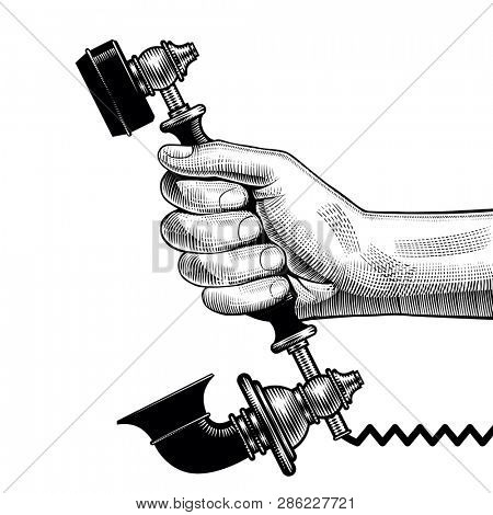 Man's hand of man with a receiver of retro black phone. Vintage engraving stylized drawing