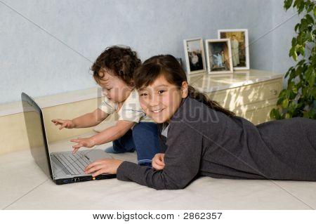 Children With Notebook.