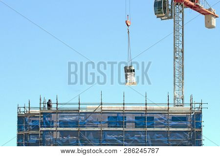 Gosford, New South Wales, Australia - November 30, 2018:  Crane Operator Managing Equipment Delivey