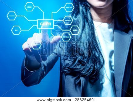 Hand Of Business Woman Pointing At Gdpr Button With Protection Structure On Virtual Screen. Cyber Se