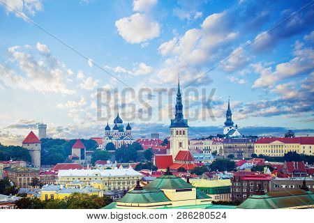 Tallinn, Estonia. Cityscape Skyline Of Old Town Of Touristic City Tallinn. Red Roofs And Colorful Cl