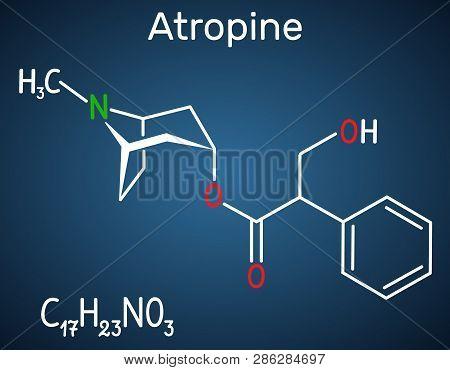 Atropine Drug Molecule. It Is Plant Alkaloid. Structural Chemical Formula On The Dark Blue Backgroun
