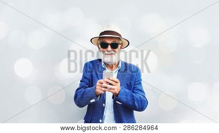 Elderly man using a mobile phone