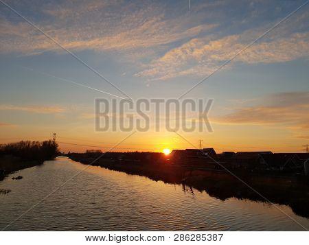 Sunset Over The Ring Canal Along The Bermweg In Nieuwerkerk Aan Den Ijssel In The Netherlands