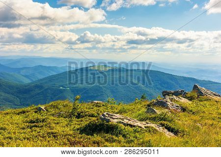 Stones On Grassy Alpine Meadow. View From The Edge Of A Hill. Beautiful Summer Landscape In Mountain