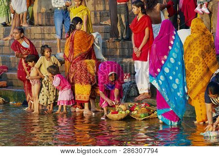 Varanasi, India - March 25, 2007: Unidentified Women Pilgrims Pray At The Bank Of The Holy Ganges Ri