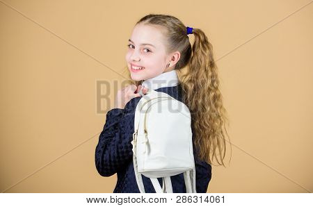 Carrying things in backpack. Schoolgirl ponytails hairstyle with small backpack. Learn how fit backpack correctly. Girl little fashionable cutie carry backpack. Popular useful fashion accessory poster