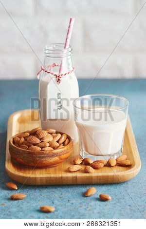 Vegan substitute dairy milk. Glass with non-dairy milk and ingredients.