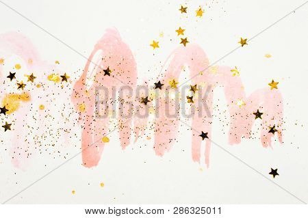 Golden glitter and glittering stars on abstract pink watercolor splashes in vintage nostalgic colors. poster