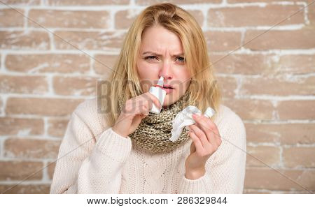 Having The Sniffles. Cute Woman Nursing Nasal Cold Or Allergy. Sick Woman Injecting Drops Into Nose.