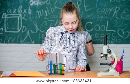 Observe Chemical Reactions. Chemical Reaction Much More Exciting Than Theory. Girls Working Chemical