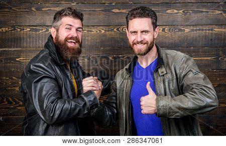 Handshake Symbol Of Successful Deal. Have Agreed. Brutal Bearded Men Wear Leather Jackets Shaking Ha