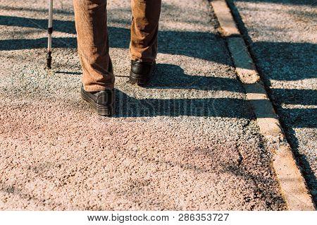 Senior Male Walking With Stick On Street. Old Man On The Sidewalk.