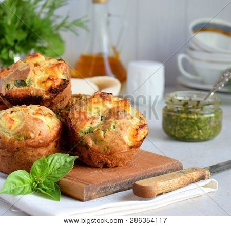 Freshly Baked Muffins With Spinach, Sweet Potatoes And Feta Cheese On White Background. Healthy Food