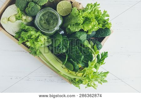 Green Vegetable Juice In A Mason Jar With Ingredients: Spinach, Celery, Cucumber, Lettuce, Ginger, L