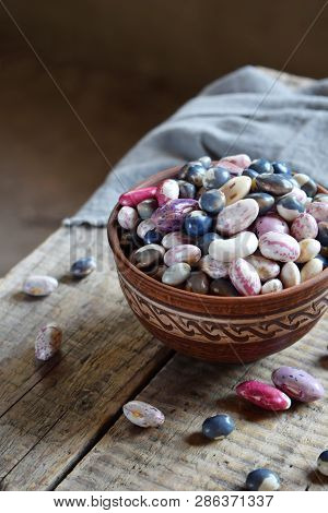 Assortment Of Young Legumes And Beans Of Different Varieties And Colors In A Clay Bowl. Raw Food. He