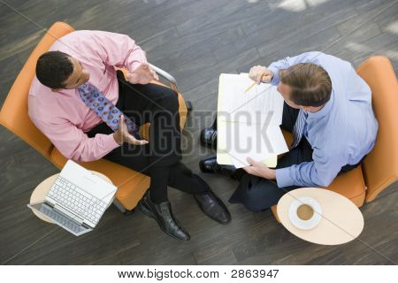 Wo Businessmen Having Meeting