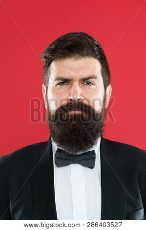 Man bearded hipster wear classic suit outfit. Classy style. Take good care of suit. Elegancy and male style. Businessman or host fashionable outfit on red background. Fashion concept. Formal outfit. poster