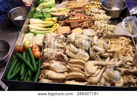 Taiwan Night Food Market - Miaokou Night Market In Keelung. Chicken Meat And Other Ingredients For L