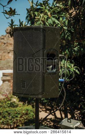 Black Speaker On A Garden At The Roman Theater Of Merida