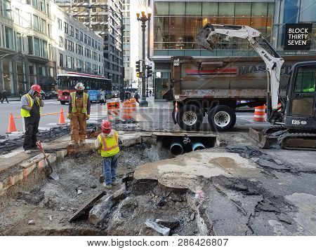 Construction Workers, Road Workers, Maintenance, Tearing Up Public Street To Replace Broken Pipes Be