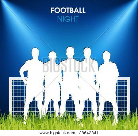 soccer team on the grass in the spotlight