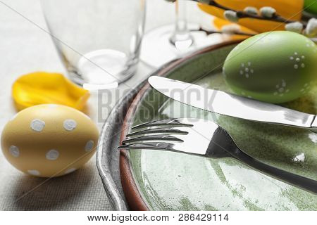 Festive Easter Table Setting With Painted Eggs On Light Background, Closeup