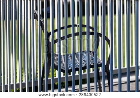 Gazebo Fence Railing With Ornate Wrought Iron Bench Inside