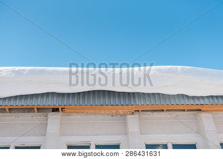 Snow On The Roof. Large Snow Drift On The Roof. Roof In Winter.