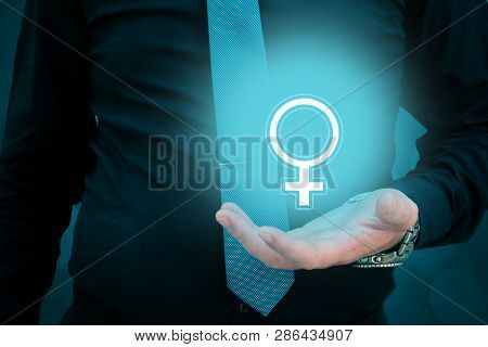 Businessman Holding Woman Gender Sign In His Hand. Man Taking Care Of A Woman. Woman Rights Protecti