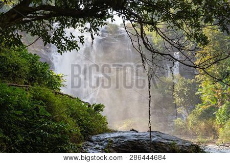 Waterfall Flowing From The Rock. Mountain River Waterfall Landscape. Waterfall Background
