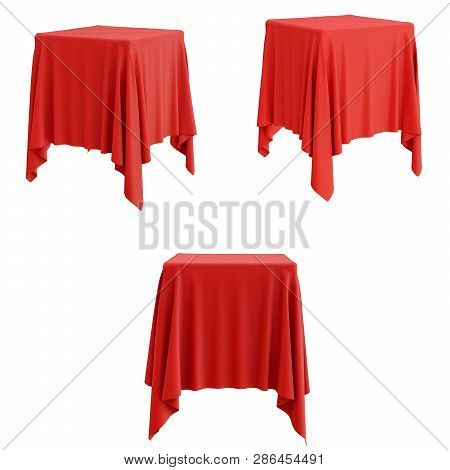 Set Of Red Cloth On A Square Pedestal Isolated On White. 3d Illustration