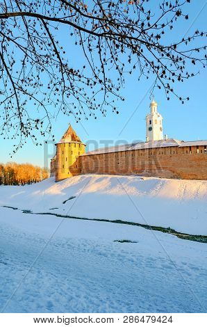 Veliky Novgorod, Russia. The Metropolitan Tower and clock tower of Novgorod Kremlin at winter sunset in Veliky Novgorod Russia poster