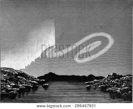 Aurora borealis in the shape of a snake, vintage engraved illustration. From the Universe and Humanity, 1910.