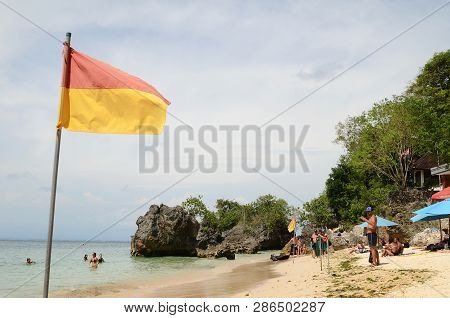 Bali, Indonesia- 14 Feb, 2019: Flag Showing Edge Of Lifeguard Safety Zone On Beach At Padang Padang