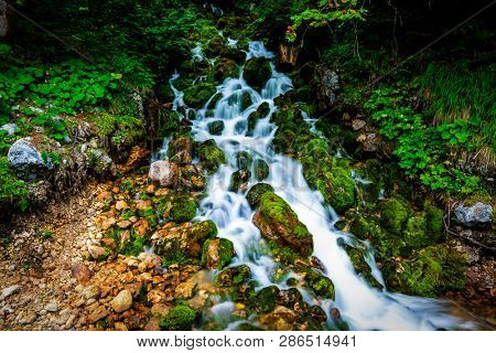 Majestic landscape of white water river in Dolomites mountains near Cortina d'Ampezzo , Eastern Dolomites, Italy Europe. Stunning long exposure nature scenery and scenic travel destination