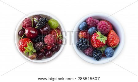 Top View. Fruits And Berries In Bowl Isolated On White Background. Ripe Raspberries, Cherries, Straw