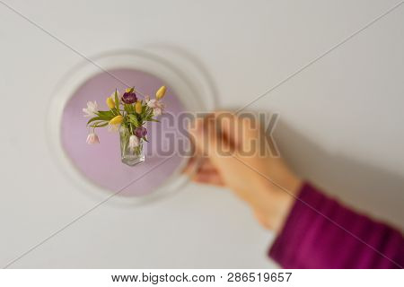 Abstract Looking Into Mirror And Seeing Floral Arrangement