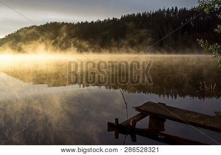 Sunrise On The River. The Beauty Of Sunrise. River Against The Sunrise. Early Morning, Fog Over The