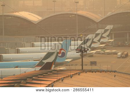 An Airplane Landing At Dusk. Feb 2015