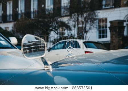 London,uk - February 23, 2019: Close Up Of A Bonnet Star Badge On Old Blue Mercedes-benz 600 Parked