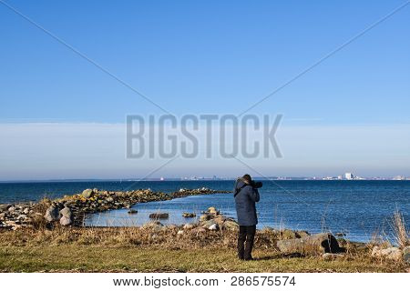 Beautiful Spring Season Day With A Photographer By The Coast Of The Swedish Island Oland