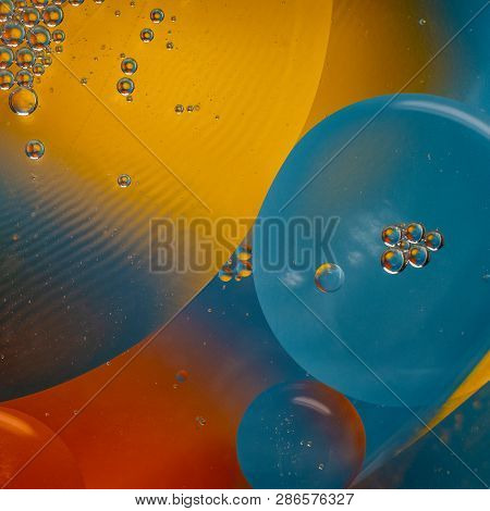 A Bright Cosmic Abstraction With A Lot Of Multicolored And Different-sized Circles.