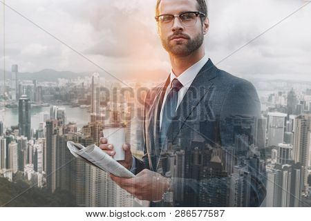 Business Expert. Close-up Portrait Of Handsome Man Holding Popular Newspaper And Cup Of Coffee While